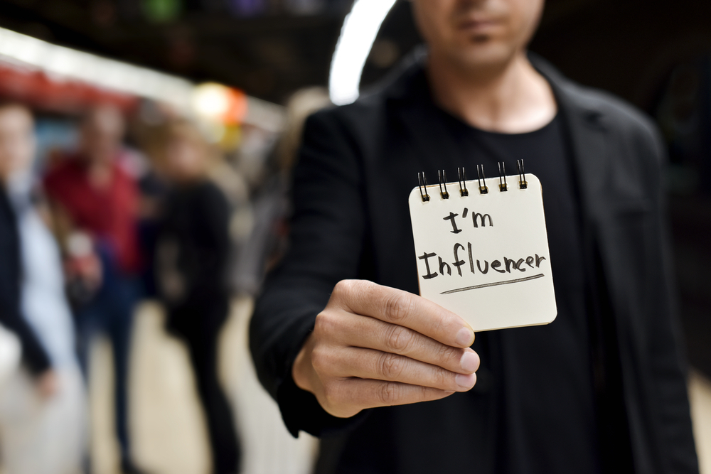 Photo of man holding a paper notes